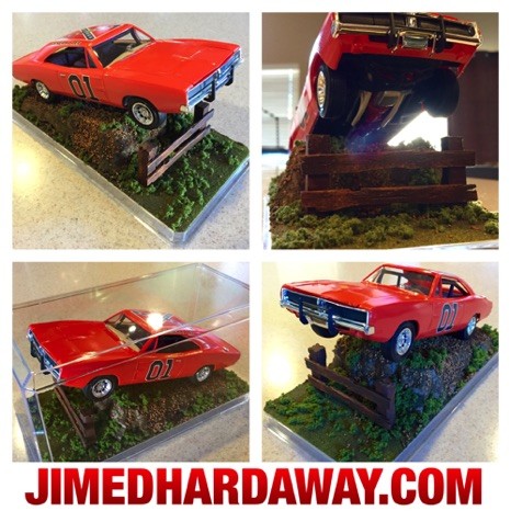 Display for my 1/25 scale Dukes of Hazzard General Lee model ('69 Dodge Charger). I made a dirt-hill jump using styrofoam, paint, glue, popsicle sticks for the fencing, and model train scenery materials. Yeeeee hawwwww!!
