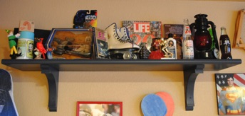 Decor shelves in the man cave! Start picking at thrift stores, flee markets, and antique stores for vintage items. Shelves can be purchased or built. There are lots of plans online. Always great eye-catchers and make the man cave ultimate!