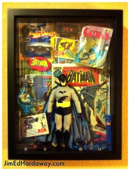 Batman Collection Shadow Box. This box displays some of my Batman stuff. The box is big enough to display a small book, cars, a large action figure, a comic book, trading cards, and more!