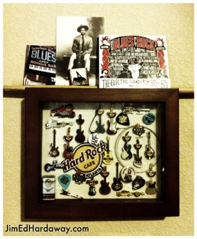 Hard Rock Pins Shadow Box. This box displays some my collectable Hard Rock Cafe' guitar pins. I accented the box with guitar picks, some wound guitar strings, drum sticks, and some blues photos, etc.